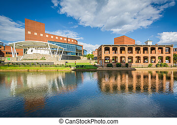 Buildings along the Reedy River, in downtown Greenville,...