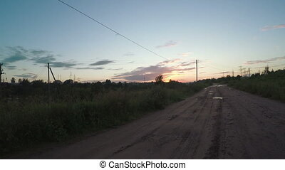 Country road at sunset - Wet dirt road at sunset