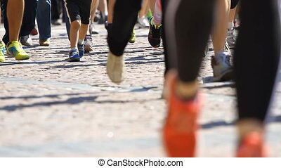 Legs of people running marathon