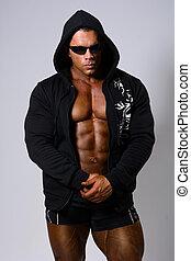 Muscular, homem, em, escuro, ÓCULOS