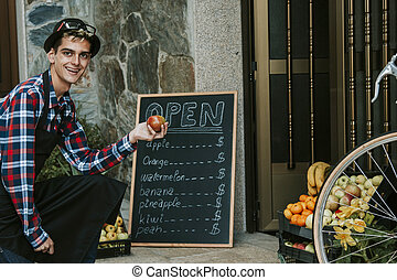 young man working in the fruit shop vintage