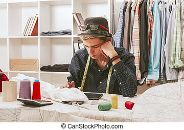 casual young staff blogger shopper in the textile workshop