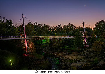 Bridge over the Reedy River at twilight, at the Falls Park...