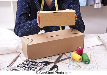 young man with cardboard boxes for shipping workshop