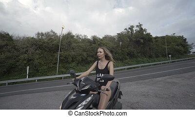 Pretty woman in black swimwear on the motor scooter - Video...