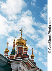 a Orthodox temple - golden domes and crosses on the Orthodox...
