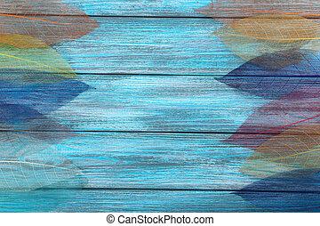 Skeleton leafs on blue wooden background