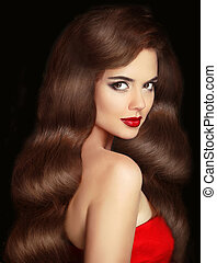 Brunette girl with long shiny wavy hair and red lips makeup....