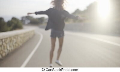 Beautiful skinny girl in shorts running around and jumping...