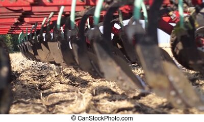 Agricultural equipment in the field - The drill is part of...