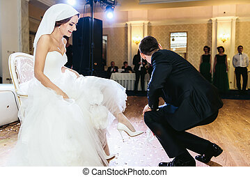 Fiance staying on kneels before a bride