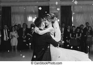 Bride hugs fiance while dancing in the restaurant