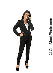 attractive latin businesswoman in formal office suit smiling...