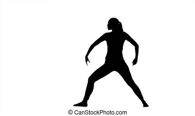 Girl shows the pose of the hero. Silhouette - Girl shows the...