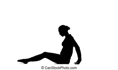Girl shows the pose reverse plank. Silhouette - Girl shows...