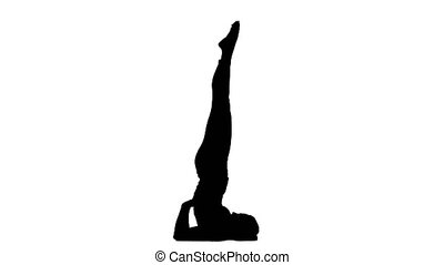 Girl shows the pose legs up. Silhouette - Girl shows the...