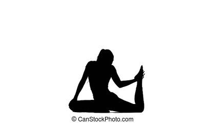 Girl engaged in yoga. Silhouette - Girl engaged in yoga,...