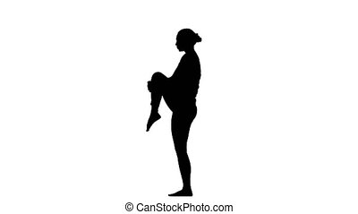 Girl shows the pose balance on one leg. Silhouette - Girl...