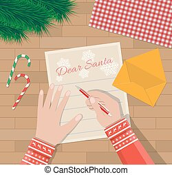 Child Hand with pen Writing letter to santa claus. wooden...