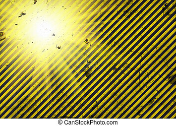 Shining warning black and yellow diagonal lines in grunge...