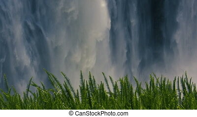 Detailed view of falling misty water at Victoria Falls -...
