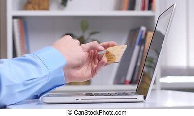 Man making online shopping with laptop. Close up - Man using...