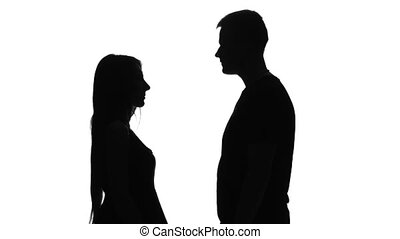 Silhouette of a loving couple. Silhouette. White -...