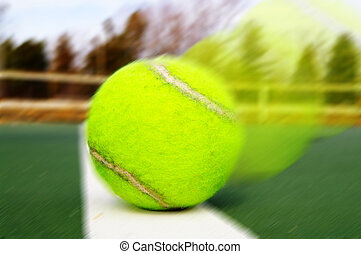 Closeup of a tennis ball on the boundary line