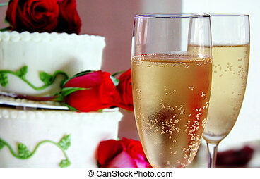 Champagne glasses and wedding cake with roses