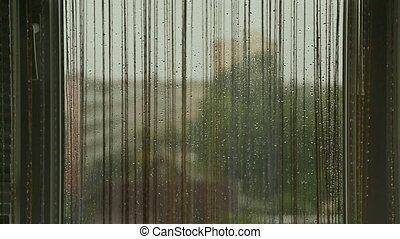 The window of the House in rainy cloudy weather.