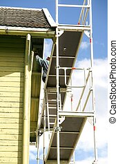 Painter on a scaffold - Man on a scaffold painting his old...