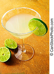 Margarita martini with a twist of lime on textured...