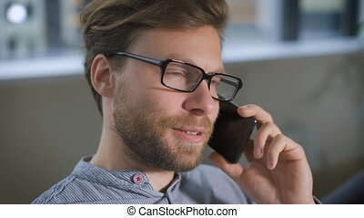 Portrait of young smiling man talk on mobile phone with his girlfriend.