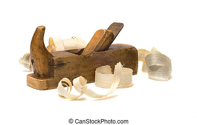 Plane and shavings. - Old wooden plane and chips on a white...