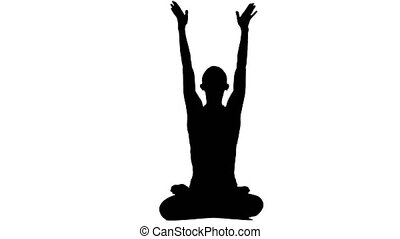 Silhouette woman meditating in a yoga pose. White...