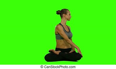 Pretty woman doing yoga exercises. Green screen