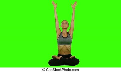 Woman doing yoga meditation. Green screen - Girl in the...