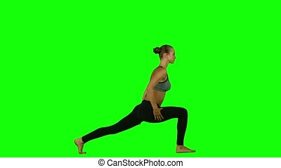 Yoga poses woman. Green screen - Young and beautiful girl in...