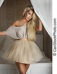 Blonde fashionable lady posing. - Fashionable blonde...