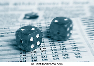 Two dice on a newspaper stock market page