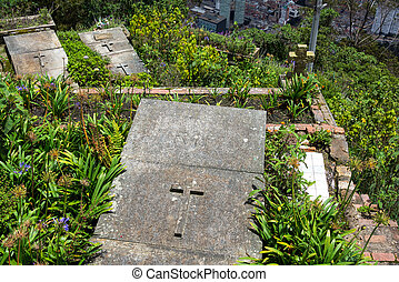 Graves on Monserrate in Colombia - Graves at the top of...