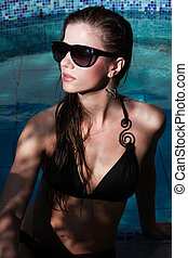Woman and swimming pool - Young attractiv woman in...