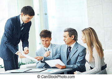 boss with digital tablet and his business team