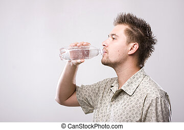 Drinking water - Young man drinking clean water from bottle