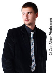 man in black suit - young attractive man in a black suit...
