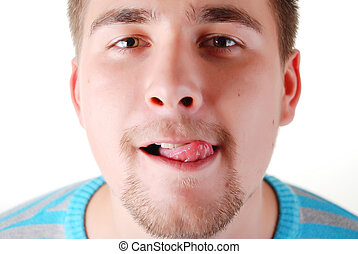 young funny man - portrait of a young funny man with tongue