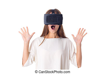 Woman using VR glasses - Young amazed woman in white shirt...