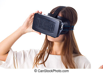 Woman using VR glasses - Nice young woman in white shirt...