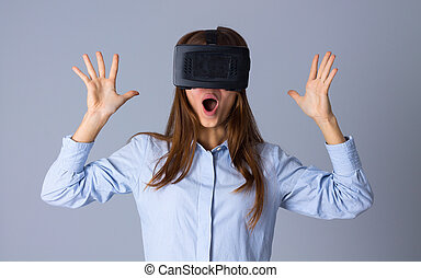 Woman using VR glasses - Young amuzed woman in blue shirt...