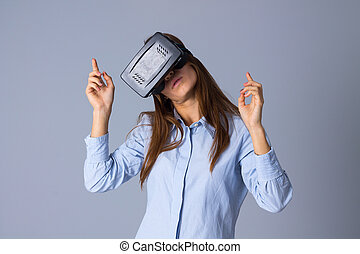 Woman using VR glasses - Beautiful young woman in blue shirt...